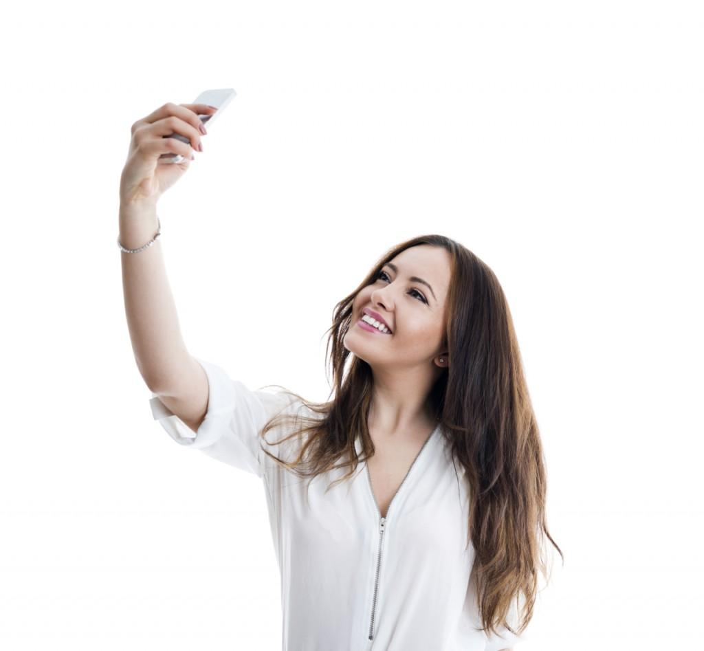 Beautiful woman taking a selfie